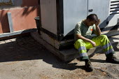Firefighter takes a break from fighting a pine forest fire near Ostia, South West Rome, Italy - Jess Hurd - 25-07-2008