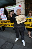 Parents and teachers from the Anti Academies Alliance, dressed as spivs and fat cats protest outside hedge fund charity HQ ARK. London. - Jess Hurd - 26-09-2008