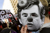 Gordon Brown clown mask. Stop the War demonstration outside Labour Party Conference. Stop government war-mongering, troops out. Manchester. - Jess Hurd - 20-09-2008