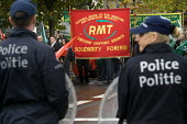 RMT demonstration is prevented from marching to the European Parliament by Brussels police force. Protest against EU Maritime Regulations which have forced the tendering of the Clyde and Hebrides ferr... - Jess Hurd - 2000s,2008,activist,activists,adult,adults,against,banner,banners,bigotry,Brussels,CAMPAIGN,campaigner,campaigners,CAMPAIGNING,CAMPAIGNS,DEMONSTRATING,demonstration,DEMONSTRATIONS,DISCRIMINATION,equal