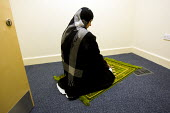 Employee prayer room at Job Centre Plus, Newham, East London. - Jess Hurd - &,2000s,2008,agency,asian,asians,BAME,BAMEs,belief,Black,BME,bmes,cities,city,conviction,diversity,dress,employee,employees,Employment,ethnic,ethnicity,faith,female,GOD,hajib,hajib scarf,hajibs,headsc