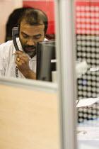 Job Centre Plus, Newham, East London. - Jess Hurd - 2000s,2008,agency,asian,asians,BAME,BAMEs,benefit,benefits,Black,BME,bmes,calls,cities,city,communicating,communication,diversity,employee,employees,Employment,ethnic,ethnicity,job,Jobcentre Plus,jobl