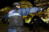 Canary Wharf security guard obstructing photographers during dancing on the Grave of Capitalism, Anti Capitalist Halloween Street Party. Canary Wharf London - Jess Hurd - 2000s,2008,activist,activists,American,americans,anti capitalism,bank,banking,banks,CAMPAIGN,campaigner,campaigners,CAMPAIGNING,CAMPAIGNS,Canary Wharf,capitalism,capitalist,Citi,Citibank,Citigroup,CLJ