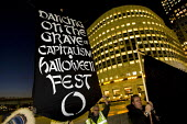 Dancing on the Grave of Capitalism! � Anti Capitalist Halloween Street Party. Canary Wharf London. - Jess Hurd - 2000s,2008,activist,activists,American,americans,anti capitalism,anti capitalist anti capitalism,bank,banking,banks,CAMPAIGN,campaigner,campaigners,CAMPAIGNING,CAMPAIGNS,Canary Wharf,capitalism,capita