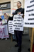 Peter Tatchell, Outrage joins a demonstration Against Human Rights Abuses and Deportation of Ugandan Asylum Seekers outside the Ugandan Embassy on Independence day. Organized by the NUs and GayRIghtsU... - Jess Hurd - 09-10-2008