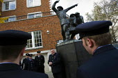 Firefighters lay a wreath at the St Paul's monument Blitz Memorial Statue in Remembrance of firefighters losing their lives at work. London. - Jess Hurd - 12-11-2008