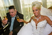 Irish travellers Nora Quilligan and Danny Sheridan from Dale Farm celebrate their wedding day. The bride takes her first alcoholic drink, as is traditional. Many weddings are taking place ahead of the... - Jess Hurd - 10-12-2008