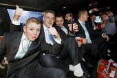 Best men in the back of a limo celebrating the wedding of Nora Quilligan and Danny Sheridan Irish travellers from Dale Farm. Basildon, Essex. - Jess Hurd - 2000s,2008,adolescence,adolescent,adolescents,alcohol,AUTO,AUTOMOBILE,AUTOMOBILES,AUTOMOTIVE,BAME,BAMEs,bigotry,BME,bmes,car,cars,CELEBRATE,celebrating,celebration,CELEBRATIONS,DISCRIMINATION,diversit