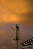 The statue of the Goddess Athena, the Greek Goddess of War and Wisdom, with stormy clouds. Athens, Greece - Jess Hurd - 23-12-2008