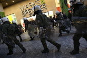 Riot police in the centre of Athens. Demonstration called after the fatal shooting by the police on Dec. 6 of a 15-year-old, Alexandros Grigorolopoulos. Athens, Greece - Jess Hurd - 2000s,2008,activist,activists,adult,adults,against,anti,Anti Capitalist,bought,buy,buyer,buyers,buying,CAMPAIGN,campaigner,campaigners,CAMPAIGNING,CAMPAIGNS,capitalism,capitalist,CLJ,commodities,commo