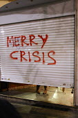 Merry Crisis graffiti. Demonstration called after the fatal shooting by the police on Dec. 6 of a 15-year-old, Alexandros Grigorolopoulos. Athens, Greece - Jess Hurd - 24-12-2008