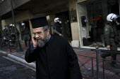 Christian Greek Orthodox Priest. Demonstration called after the fatal shooting by the police on Dec. 6 of a 15-year-old, Alexandros Grigorolopoulos. Athens, Greece - Jess Hurd - 2000s,2008,activist,activists,adult,adults,against,Alexandros,anti,Anti Capitalist,CAMPAIGN,campaigner,campaigners,CAMPAIGNING,CAMPAIGNS,capitalism,capitalist,conflict,conflicts,DEMONSTRATING,Demonstr