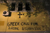 Anti capitalist graffiti for a global insurrection. Demonstration called after the fatal shooting by the police on Dec. 6 of a 15-year-old, Alexandros Grigorolopoulos. Athens, Greece - Jess Hurd - 18-12-2008
