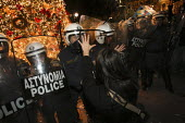 Riot police defend a Christmas tree in Syntagma Square. Demonstration called after the fatal shooting by the police on Dec. 6 of a 15-year-old, Alexandros Grigorolopoulos. Athens, Greece - Jess Hurd - 20-12-2008