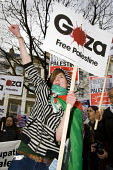 Gaza protest against the BBC's refusal to broadcast a charity appeal to raise emergency funds for people in the Gaza strip. London. - Jess Hurd - 2000s,2009,activist,activists,adolescence,adolescent,adolescents,against,appeal,BBC,broadcast,BROADCASTING,CAMPAIGN,campaigner,campaigners,CAMPAIGNING,CAMPAIGNS,charitable,charity,DEMONSTRATING,DEMONS