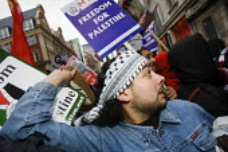 Protesters throw shoes at the Israeli Embassy. National Palestine Demonstration, Stop Gaza Massacre. London. - Jess Hurd - ,2000s,2009,activist,activists,anger,angry,anti war,BAME,BAMEs,Black,BME,bmes,CAMPAIGN,campaigner,campaigners,CAMPAIGNING,CAMPAIGNS,DEMONSTRATING,demonstration,DEMONSTRATIONS,diversity,EMOTION,EMOTION
