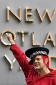 Woman dresses with a police hat at I'm a Photographer Not a Terrorist NUJ media event outside New Scotland Yard. Press and amateur photographers gather outside Police HQ to highlight infringement of p... - Jess Hurd - 16-02-2009