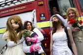 The Brides of March ambush firefighters from Lambeth fire station. 1st London Bridalthon. South Bank. - Jess Hurd - 14-03-2009