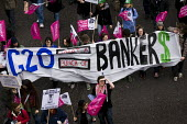 Oxfam. What a bunch of Bankers banner. Put People First march for Jobs, Justice and Climate ahead of the London G20 Summit on the recession. - Jess Hurd - ,2000s,2009,activist,activists,agencies,agency,aid,assistance,bank,banker,bankers,banking,banks,banner,banners,CAMPAIGN,campaigner,campaigners,CAMPAIGNING,CAMPAIGNS,charitable,charities,charity,Climat