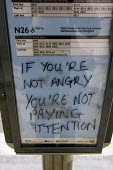 If you're not angry you're not paying attention graffiti at a bus stop. City of London. - Jess Hurd - 2000s,2009,activist,activists,Anti Capitalist,bus,bus service,BUSES,CAMPAIGN,campaigner,campaigners,CAMPAIGNING,CAMPAIGNS,capitalism,capitalist,death,deaths,DEMONSTRATING,demonstration,DEMONSTRATIONS,