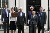 Alistair Darling, Chancellor and his Treasury team: Steven Timms, Yvette Cooper, Paul Myners (Baron Myners), Angela Eagle, and Ian Pearson, present the Budget. Downing Street London. - Jess Hurd - 2000s,2009,briefcase,Budget Box,FEMALE,Labour Party,mp,mps,people,person,persons,pol,POL Politics,political,politician,politicians,politics,Street,woman,women
