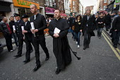 Lesbian and gay police and a priest march down Old Compton St for a vigil 10 years since the homophobic nail-bomb attack where three people died. Soho. London. - Jess Hurd - 30-04-2009
