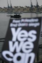 Police boat patrols the Dockland. Stop the War demonstration. G20 protests, Excel. London. - Jess Hurd - 2000s,2009,activist,activists,adult,adults,Afghanistan,anti capitalism,Anti Capitalist,anti war,boat,boats,CAMPAIGN,campaigner,campaigners,CAMPAIGNING,CAMPAIGNS,CLJ crime law and justice,DEMONSTRATING