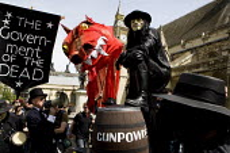 Sack Parliament. Protesters dress as Guy Fawkes with gunpowder plot to blow up Parliament. London. - Jess Hurd - 2000s,2009,activist,activists,adult,adults,assault,assaults,barrel,barrel of,barrels,CAMPAIGN,campaigner,campaigners,CAMPAIGNING,CAMPAIGNS,corrupt,corruption,Dead,DEMONSTRATING,demonstration,DEMONSTRA
