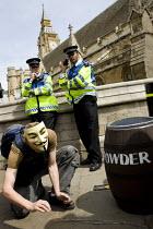 Sack Parliament. Protesters dress as Guy Fawkes with gunpowder plot to blow up Parliament. London. - Jess Hurd - 2000s,2009,activist,activists,adult,adults,assault,assaults,barrel,barrel of,barrels,CAMPAIGN,campaigner,campaigners,CAMPAIGNING,CAMPAIGNS,CLJ,corrupt,corruption,DEMONSTRATING,demonstration,DEMONSTRAT