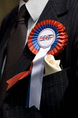 BNP suit and rosette. The BNP launch their European Election Manifesto at a secret location. Grays, Essex - Jess Hurd - 11-05-2009