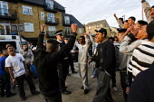 Bengali youth celebrate when the police say the will leave their estate after the Mela, Whitechapel, East London. - Jess Hurd - 2000s,2009,adult,adults,anger,angry,arrest,arrested,arresting,asian,asians,BAME,BAMEs,bigotry,Black,BME,bmes,cities,city,CLJ crime law and justice,communities,community,council estate,council services