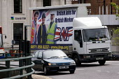 BNP election Truth Truck. British Jobs for British Workers slogan mobile election hoarding driving around Unite protest for Jobs, Birmingham. The workers featured on the poster are American and from a... - Jess Hurd - 16-05-2009