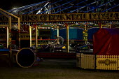 Fairground workers pack up the dodgems or bumpercars, Carters Steam Fair, Victoria Park. East London. - Jess Hurd - 21-06-2009