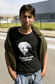 Einstein Was a Refugee Tshirt. Refugees from the war in Afghanistan shelter in the jungle, woods in Calais where they are forced to sleep rough. France. - Jess Hurd - 2000s,2009,Afghan Afghans,Afghanistan,Albert Einstein,asylum seeker,asylum seeker,BME black,camp,camps,Diaspora,displaced,ethnic,ETHNICITY,eu,Europe,european,europeans,eurozone,foreign,foreigner,forei