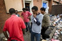 Eritrean refugees squat a derelict, abandoned house in Calais. France. - Jess Hurd - 2000s,2009,abandoned,Africa,african,africans,asylum seeker,asylum seeker,BME black,derelict,DERELICTION,Diaspora,displaced,Eritrea,Eritrean,Eritreans,ethnic,ETHNICITY,eu,Europe,european,europeans,euro