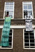 Students occupy the SOAS Principal, Paul Webley's office over the immigration raid and the deportation of 9 ISS subcontracted cleaners who had just had a unionising fair pay campaign. London. - Jess Hurd - 2000s,2009,activist,activists,African,against,and,anti,Asian,banner,banners,campaign,campaigner,campaigners,campaigning,CAMPAIGNS,civil disobedience,cleaner,cleaners,CLEANING,cleansing,DEMONSTRATING,d