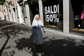 Nun walks past a 50 sale sign in Rome. Italy. - Jess Hurd - &,2000s,2009,age,ageing population,belief,bought,buy,buyer,buyers,buying,Catholic,catholicism,christian,christianity,christians,cities,city,commodities,commodity,communicating,communication,consumer,c