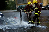 Firefighters from Bethnal Green Fire Station attend a burst water main, Tower Hamlets, East London. - Jess Hurd - 04-08-2009