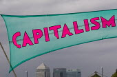 Canary Wharf and Capitalism is crisis banner. Climate Camp protestors establish on Blackheath. South East London. - Jess Hurd - 2000s,2009,action,American,americans,bank,banking,banks,Camp,camps,Canary Wharf,Capitalism,capitalist,Citi,Citibank,Citigroup,Climate,Climate Change,crisis,direct,ebf,Economic,economy,finance,FINANCIA