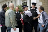 Police confront union representatives about the size of the picket line. Tower Hamlets College UCU all out indefinite strike against funding cuts which threaten ESOL classes. East London. - Jess Hurd - 27-08-2009