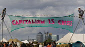 Capitalism is Crisis banner with Canary Wharf. Climate Camp on Blackheath. South East London. - Jess Hurd - 2000s,2009,action,activist,activists,against,American,americans,anti,bank,banking,banks,Camp,CAMPAIGN,campaigner,campaigners,CAMPAIGNING,CAMPAIGNS,camps,Canary Wharf,capitalism,capitalist,Citi,Citiban