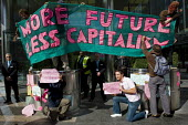 More future less capitalism banner. Climate Camp action outside Barclays Bank offices at Canary Wharf. Investers in EON. London. - Jess Hurd - 2000s,2009,action,activist,activists,against,anti,Bank,BANKS,Camp,CAMPAIGN,campaigner,campaigners,CAMPAIGNING,CAMPAIGNS,camps,capitalism,capitalist,civil disobedience,Climate,Climate Change,DEMONSTRAT