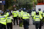 Asian youth throw bricks at the police on an English Defence League march in Birmingham - Jess Hurd - 05-09-2009