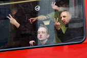 English Defence League making rude gestures and V signs as they are contained on buses to prevent them marching in Birmingham against Islamic Extremism. Chris Renton of the BNP on the right - Jess Hurd - 2000s,2009,activist,activists,against,bigotry,Birmingham,BNP,British National Party,BUS,bus service,buses,CAMPAIGN,campaigner,campaigners,CAMPAIGNING,CAMPAIGNS,communicating,communication,Defence,DEFE