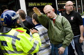 Member of the English Defence League making a Nazi Sieg Heil salute march in Birmingham against Islamic Extremism - Jess Hurd - 2000s,2009,activist,activists,adult,adults,against,bigotry,Birmingham,CAMPAIGN,campaigner,campaigners,CAMPAIGNING,CAMPAIGNS,cities,city,CLJ,Defence,DEFENSE,DEMONSTRATING,demonstration,DEMONSTRATIONS,D