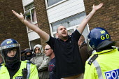 English Defence League supporters are kettled by police. Anti-fascist demonstrators and local muslim youths gathered to counter a threatened march by right wing groups outside Harrow Central Mosque. L... - Jess Hurd - 11-09-2009