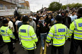 Anti-fascist demonstrators and local muslim youths gathered to counter a threatened march by right wing groups outside Harrow Central Mosque. London. - Jess Hurd - 11-09-2009
