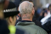 Tattoed neck. English Defence League march in Leeds - Jess Hurd - 2000s,2009,ACE,activist,activists,against,anti,arts,bigotry,CAMPAIGN,campaigner,campaigners,CAMPAIGNING,CAMPAIGNS,culture,Defence,DEFENSE,DEMONSTRATING,demonstration,DEMONSTRATIONS,DISCRIMINATION,EDL,