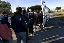 Refugees in Calais queue for food. France. - Jess Hurd - 2000s,2009,Afghan Afghans,Afghanistan,aid,assistance,asylum seeker,asylum seeker,BAME,BAMEs,bigotry,BME,bmes,charity charities,destitute,Diaspora,DISCRIMINATION,displaced,diversity,equal,equality,ethn
