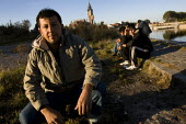 Refugees in Calais wait for food from Salam. France. - Jess Hurd - 2000s,2009,Afghan Afghans,Afghanistan,asylum seeker,asylum seeker,BAME,BAMEs,bigotry,BME,bmes,destitute,Diaspora,DISCRIMINATION,displaced,diversity,equal,equality,ethnic,ethnicity,eu,Europe,european,e